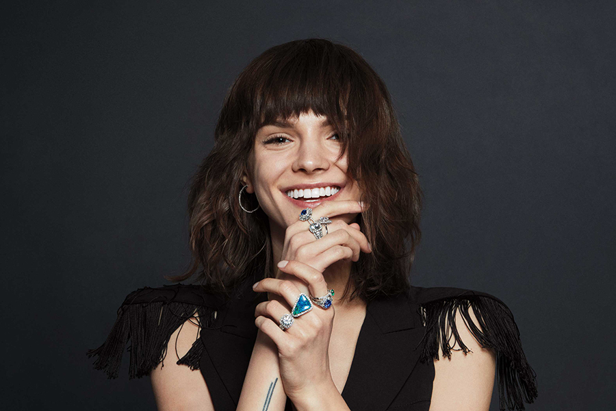 woman smiling wearing jewelry